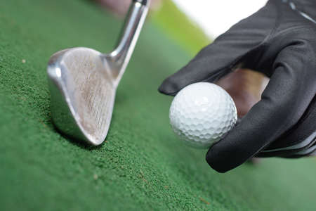 placing the golf ball Stock Photo
