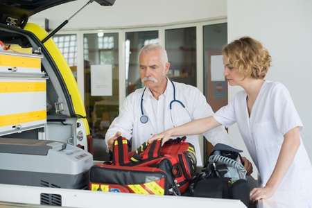 emergency respondents preparing vehicle Stock Photo