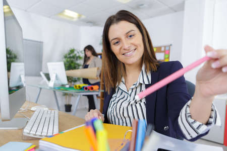 designate: office woman with pencil in hand
