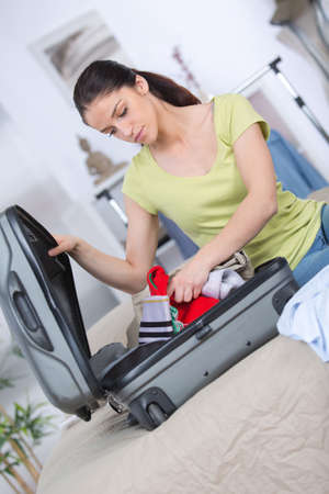 seperation: packing a suitcase Stock Photo