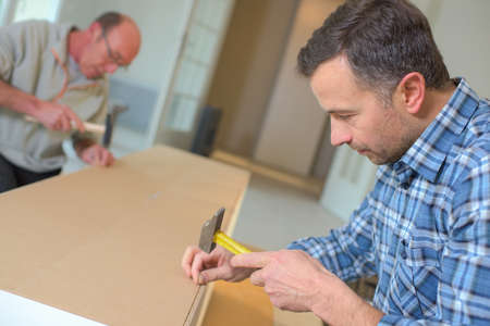 cabinetry: helping a neighbor in need Stock Photo
