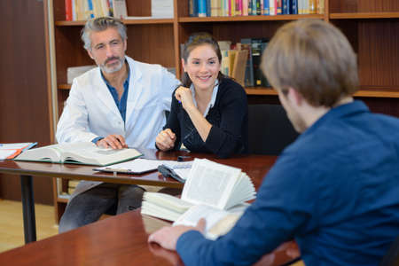 classmate: medicine student taking final exam with panel of professionals Stock Photo
