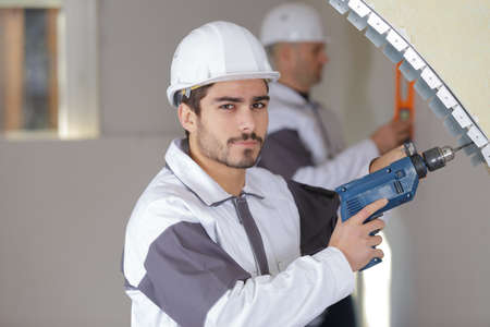 young man with a drill