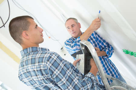 redecorate: two workers renewing apartment indoor Stock Photo