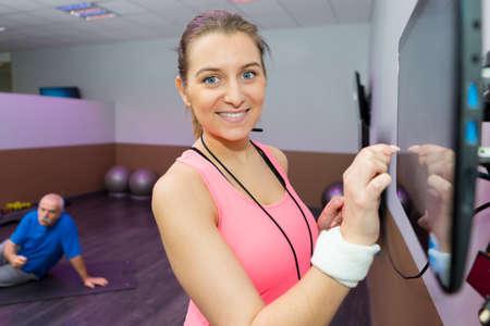 fitness instructor preparing screen