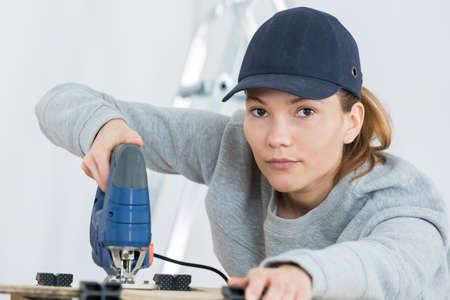 safety conscious female carpenter Stock Photo