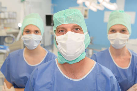 three surgeons in surgical theatre