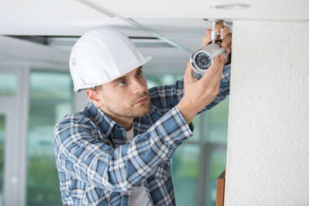 closed circuit television: professional cctv technician working Stock Photo