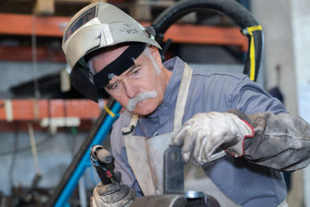 visibility: senior worker ready to weld Stock Photo