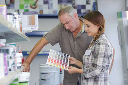 redecorate: daughter and dad hoosing wall paint colors
