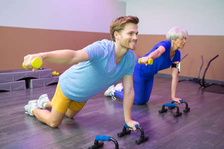 centered: female senior with physical fitness trainer