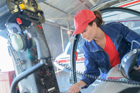 concentrate: mechanic examining under hood of car at the repair garage