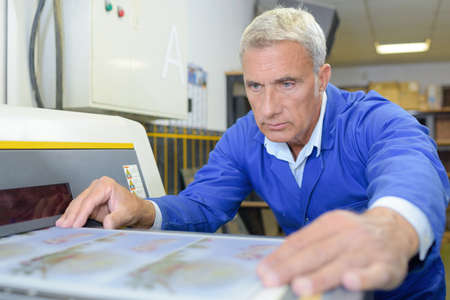 professional man working on printing system Stock Photo