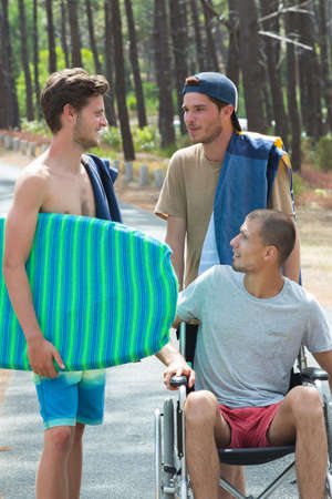 appearance: 3 teenagers arriving at the beach one is disabled