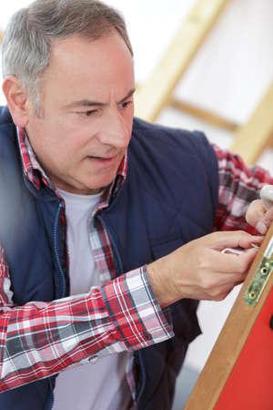 attractive builder is installing doorlock