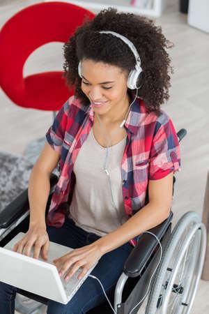 smiling disabled female university student