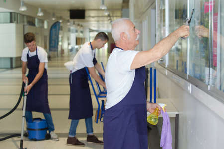 premises: portrait of professional cleaners team at work