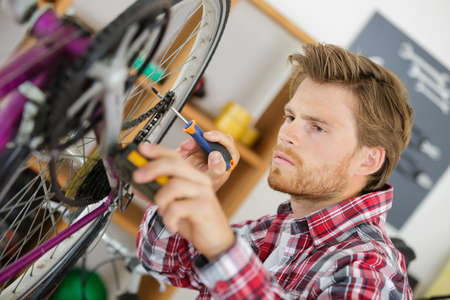 Man adjusting bicycle chain Stock Photo