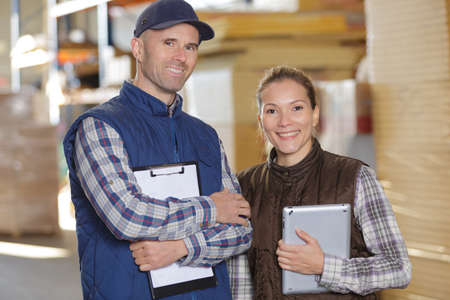papermaking: happy paper mill factory workers Stock Photo