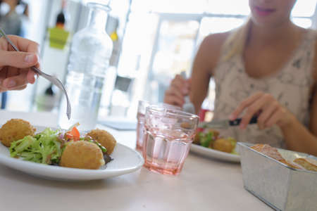 them: restaurant dishes and people eating them