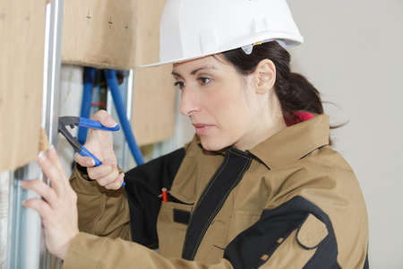 female constructor worker indoors Stock Photo