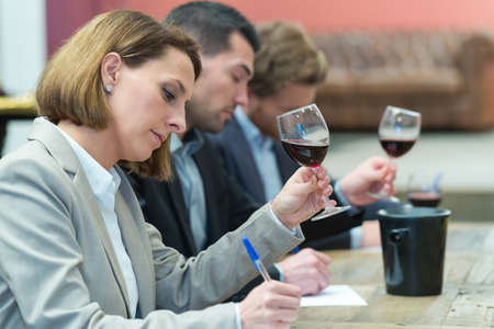 critics grading the wines for the awarding
