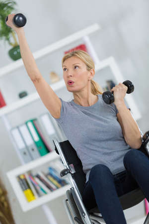 staying fit: disabled female staying fit at home