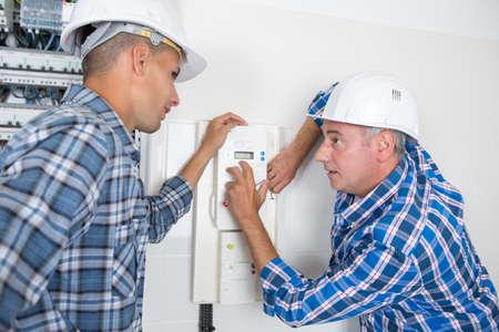 electrician training an apprentice
