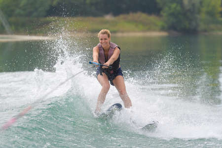 young girl water skiing on a slalom course Stock Photo