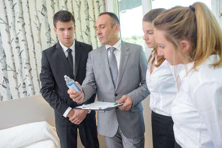 hotel staff: head of hotel houekeeping team inspecting rooms