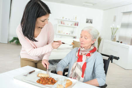 elderly lady on wheelchair and her nurse
