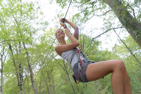 seeker: woman going on a jungle zipline adventure Stock Photo