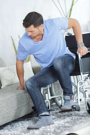 musing: man sitting on couch from wheelchair