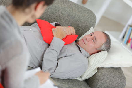 worried man on psychotherapy with doctor