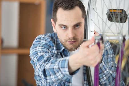 air bladder: man pumping wheel bike