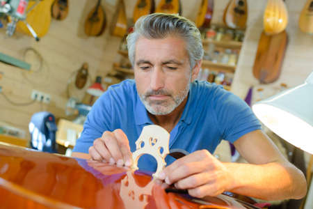 craftmanship: lute maker shop and classic music instruments