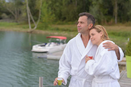 lover couple relax at the lake in holiday