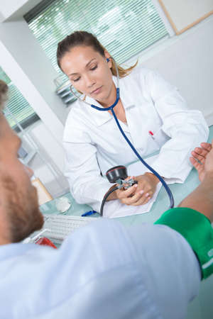 female doctor with pressure gauge Stock Photo