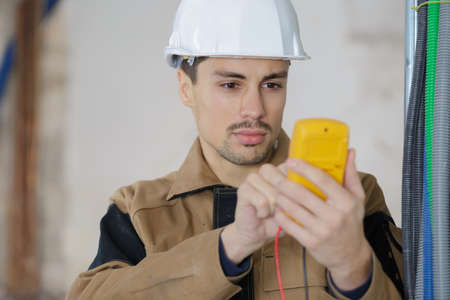 builder using a digital multimeter isolated