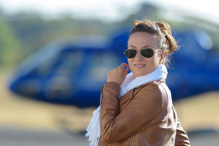 centered: pretty pilot woman on helicopter Stock Photo