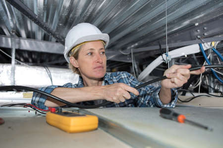 wireman: female electrician Stock Photo