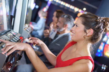 woman happy after winning on slot machine at casino