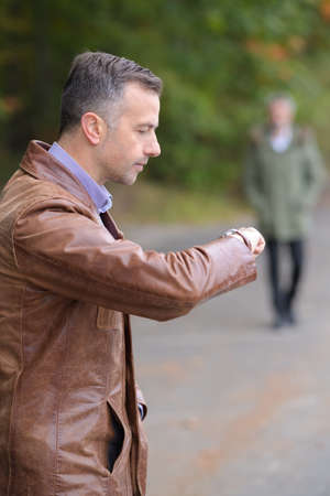 business man watching his wrist watch
