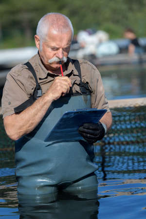 fisherman checking his clipboard