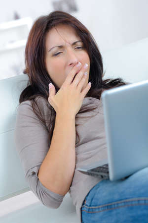 young woman yawning Stock Photo
