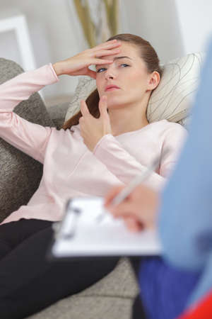 psychoanalysis: young women with depression listening to her therapist Stock Photo