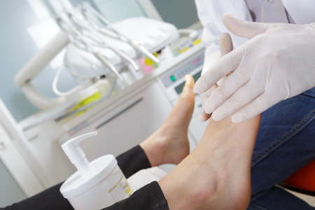 process of pedicure at beauty salon Фото со стока
