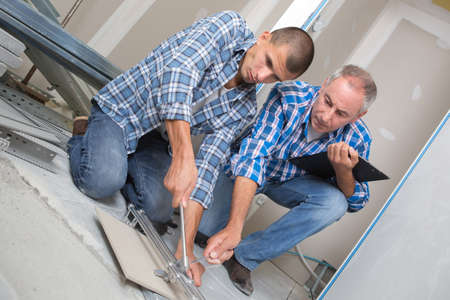 tile cutting worker working with floor tile cutting Stock Photo