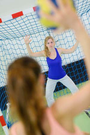 athleticism: sportswoman throwing a handball ball Stock Photo