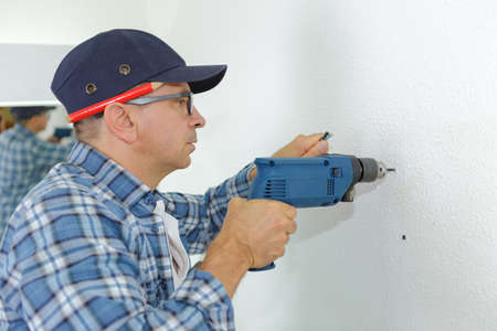 screw driver: man hold electric screw driver